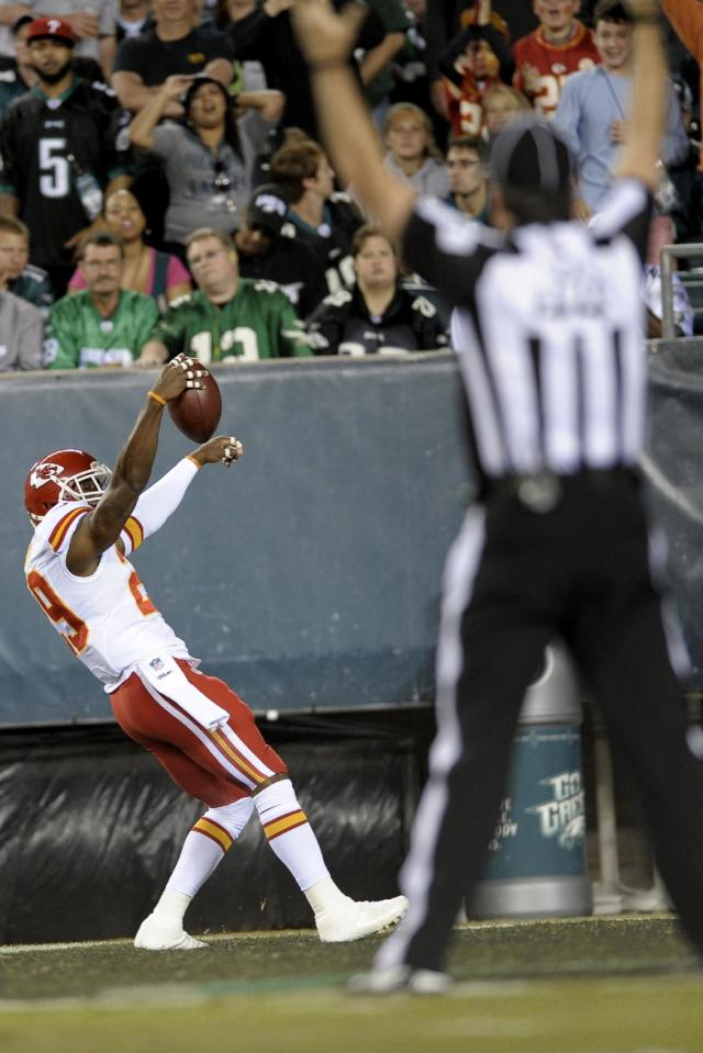 Kansas City Chiefs strong safety Eric Berry reacts after returning an interception for a touchdown during the first half of an NFL football game against the Philadelphia Eagles, Thursday, Sept. 19, 2013, in Philadelphia. (AP Photo/Michael Perez)