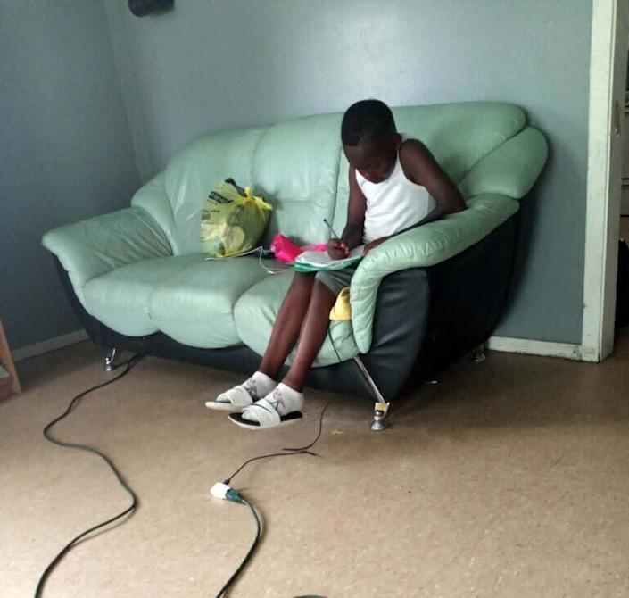 Amareon works to finish his instructional packet a few hours before the district's deadline. He had attempted to keep up with lessons his teacher posted online, but then his family became disconnected. (Photo: Courtesy of Terri Johnson)