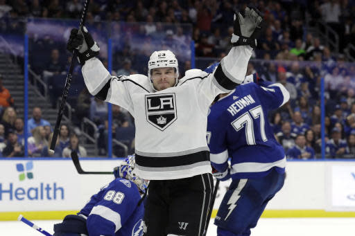 Los Angeles Kings right wing Dustin Brown (23) celebrates his goal against the Tampa Bay Lightning during the third period of an NHL hockey game Tuesday, Jan. 14, 2020, in Tampa, Fla. (AP Photo/Chris O'Meara)