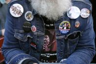 A demonstrator wears a shirt and buttons supporting President Donald Trump outside the Pennsylvania Convention Center where votes are being counted, Friday, Nov. 6, 2020, in Philadelphia. (AP Photo/Rebecca Blackwell)