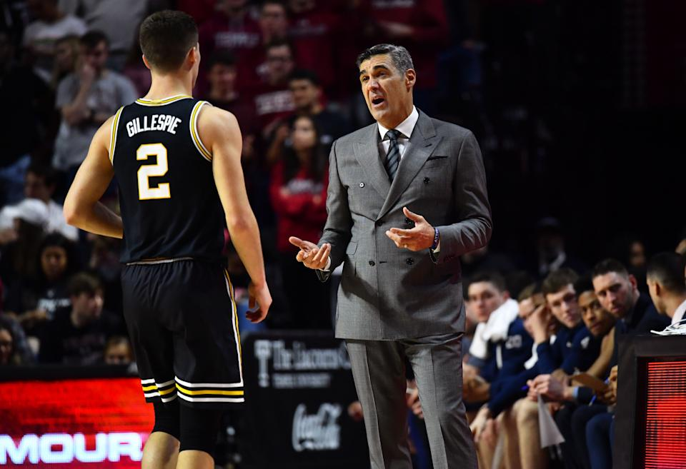 Feb 16, 2020; Philadelphia, Pennsylvania, USA; Villanova Wildcats head coach Jay Wright speaks to guard Collin Gillespie (2) in the first half during the game against the Temple Owls at Liacouras Center. Mandatory Credit: Kyle Ross-USA TODAY Sports