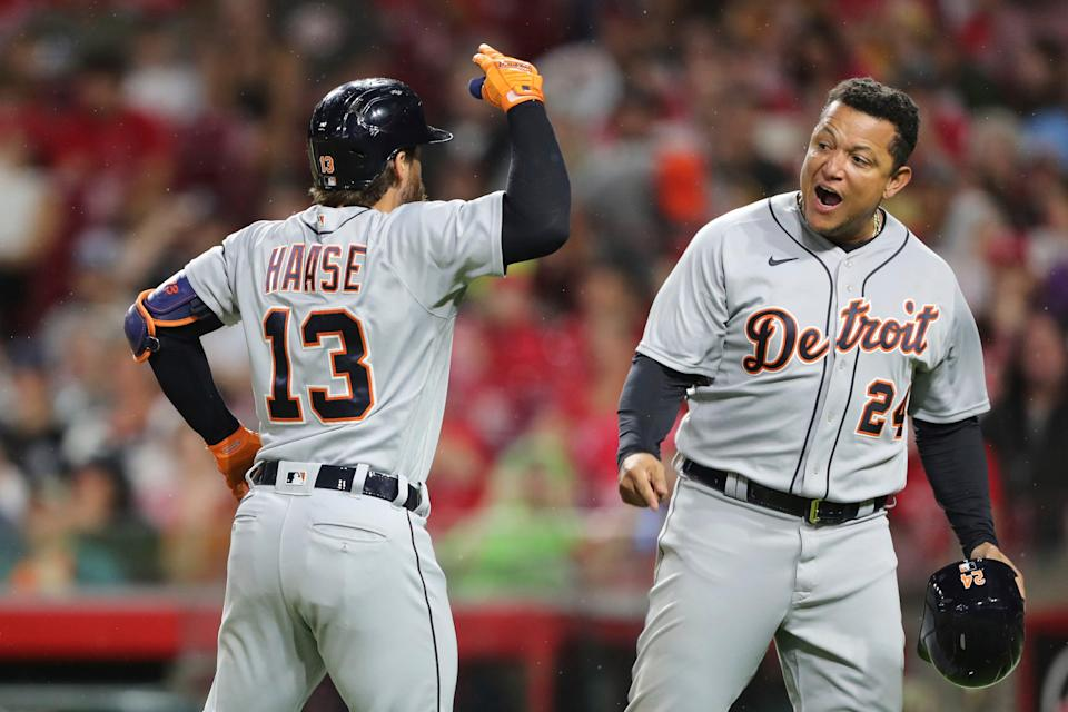 Detroit Tigers' Eric Haase (13) celebrates his three-run home run with Miguel Cabrera (24), off Cincinnati Reds starting pitcher Tyler Mahle during the third inning of a baseball game, Saturday, Sept. 4, 2021, in Cincinnati.