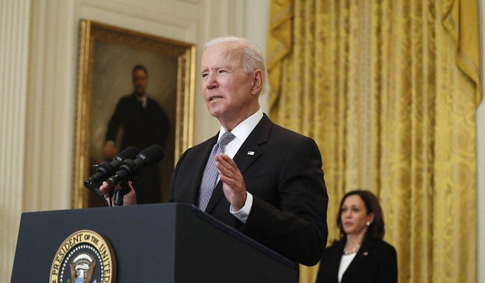US Vice-President Kamala Harris (right) listens as US President Joe Biden delivers remarks on the Covid-19 response and the vaccination programme from the East Room of the White House on Monday. Photo: TNS