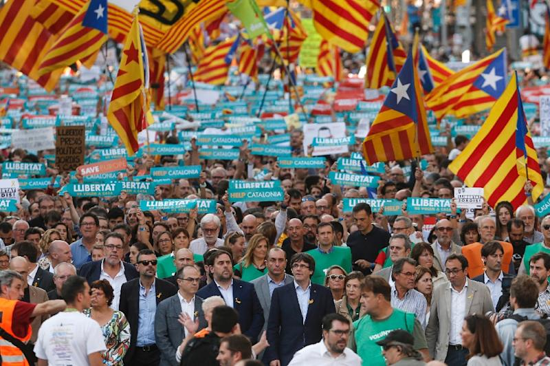 Catalan leaders including regional president Carles Puigdemont join a rally in Barcelona in support of separatists