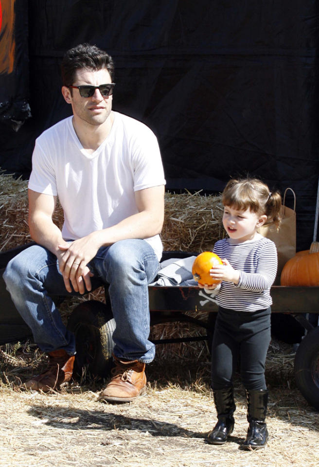 Max Greenfield having fun with his daughter at the Mr. Bones Pumpkin Patch in West Hollywood. 