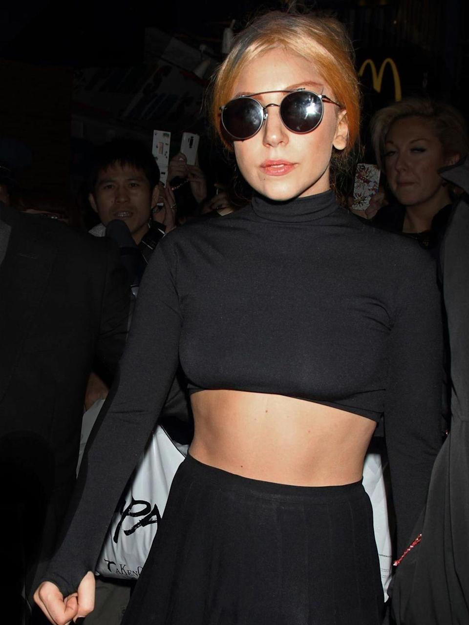 <p>Lady Gaga is spotted wearing a simple black cropped top and skirt with a pair of round frame sunglasses, from Thom Browne's first eyewear collection which is under a licensee agreement with DITA eyewear whilst out and about in Tokyo, May 2012.</p>