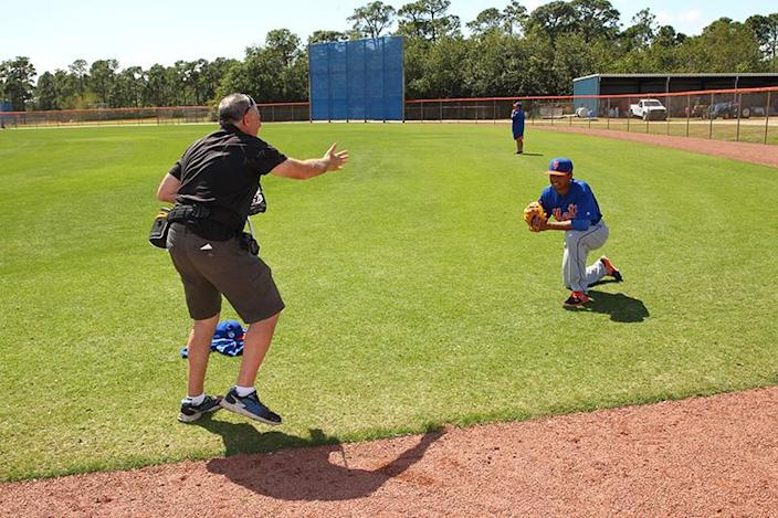 <p>Baseball Digest photographer Steve Moore directs top pitching prospect Harol Gonzalez during a photo session at the New York Mets spring training facility in Port St. Lucie, Fla., Thursday, March 2, 2017. (Gordon Donovan/Yahoo Sports) </p>