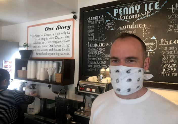 In this April 17, 2020, photo, Zachary Davis poses for a photo at The Penny Ice Creamery in Santa Cruz. An investigation by The Associated Press found that the federal Paycheck Protection Program, which was supposed to provide small businesses like Davis' with access to cash to support their employees, also provided hundreds of millions of dollars to large publicly traded companies.