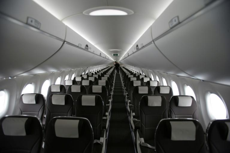 The larger than average seats are pictured inside the The Bombardier CS100 passenger jet on the opening day of the Farnborough Airshow, south west of London, on July 11, 2016
