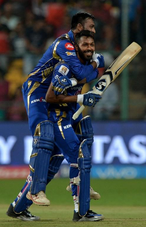 <p>Mumbai Indians batsman Krunal Pandya (TOP) hugs teammate Hardik Pandya as they celebrate their team's victory in the 2017 Indian Premier League (IPL) Twenty20 cricket match between Royal Challengers Bangalore and Mumbai Indians at The M.Chinnaswamy Stadium in Bangalore on April 14, 2017. ——IMAGE RESTRICTED TO EDITORIAL USE – STRICTLY NO COMMERCIAL USE—– / GETTYOUT—— / AFP PHOTO / Manjunath KIRAN / —-IMAGE RESTRICTED TO EDITORIAL USE – STRICTLY NO COMMERCIAL USE—– / GETTYOUT </p>
