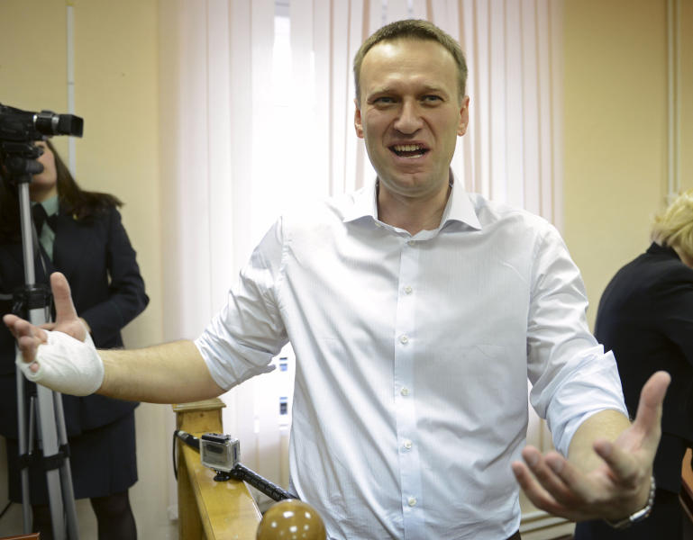 Russian opposition leader Alexei Navalny speaks to journalists after a trial in Kirov, Russia, Wednesday, April 17, 2013. The trial of Navalny accused of embezzling half a million dollars' worth of timber from a state-run company was adjourned shortly after its start Wednesday in the northwestern city. (AP Photo/Mitya Aleshkovskiy)