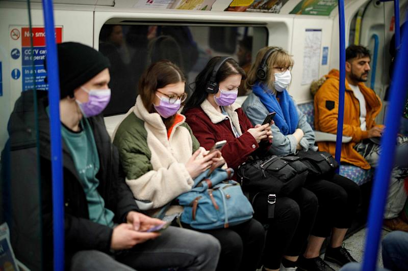 Commuters wear masks as a precaution whilst travelling on a London Underground Tube train on Wednesday: AFP via Getty Images