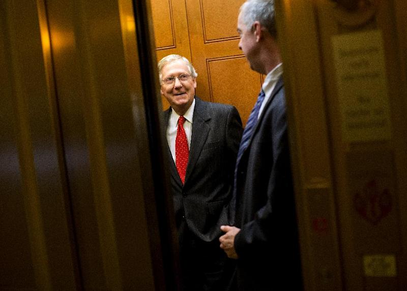 Senate Minority Leader Mitch McConnell of Ky. gets on an elevator to leave Capitol Hill in Washington, Friday, Oct. 11, 2013, for a meeting with President Obama at the White House. After weeks of ultimatums, President Barack Obama and congressional Republicans are exploring whether they can end a budget standoff that has triggered a partial government shutdown and edged Washington to the verge of a historic, economy-jarring federal default. (AP Photo/ Evan Vucci)