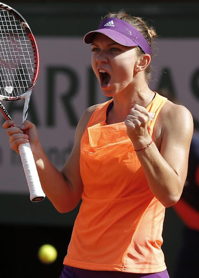 Romania's Simona Halep reacts as she wins the second set against Russia's Maria Sharapova during their final match of the French Open tennis tournament at the Roland Garros stadium, in Paris, France, Saturday, June 7, 2014. (AP Photo/Michel Euler)