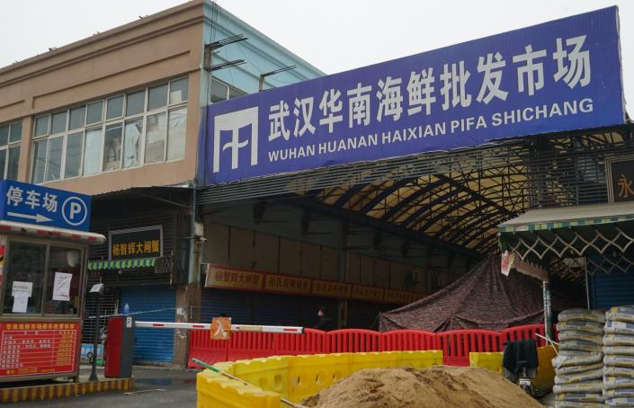 """<span class=""""caption"""">The Wuhan Huanan Wholesale Seafood Market, where the coronavirus outbreak is believed to have started, is now closed.</span> <span class=""""attribution""""><a class=""""link rapid-noclick-resp"""" href=""""http://www.apimages.com/metadata/Index/China-Outbreak/6cafa23497f74bb5a5b54500c9625e5a/3/0"""" rel=""""nofollow noopener"""" target=""""_blank"""" data-ylk=""""slk:AP Photo/Dake Kang"""">AP Photo/Dake Kang</a></span>"""
