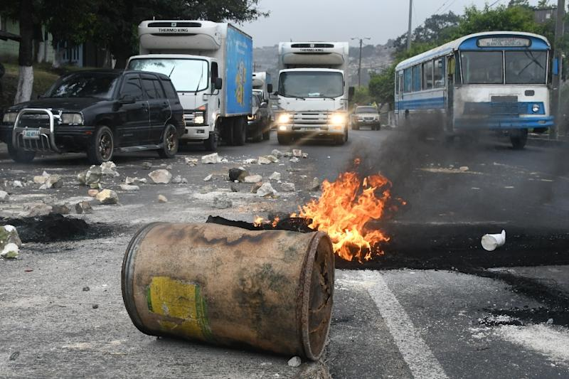 Protesters in Honduras erected burning barricades after President Juan Orlando Hernandez was declared the winner of a heavily disputed election (AFP Photo/ORLANDO SIERRA)
