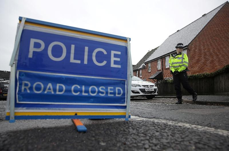 British police officers stand on duty at a cordon leading to the home of Russian spy Sergei Skripal, in Salisbury, southern England