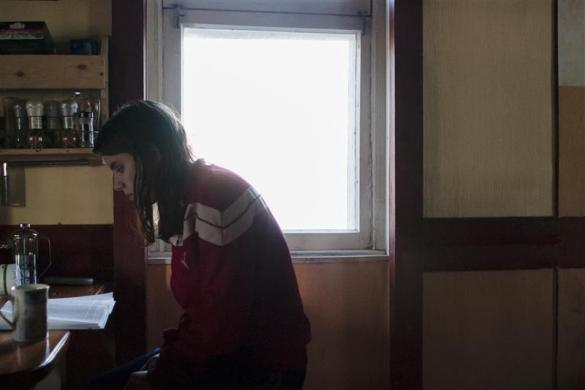 Political activist Yekaterina Samutsevich reads a book as she waits for the birth of fellow Voina member Natalia Sokol's first child Kasper in a secret hideout in Moscow, June 19, 2009. Samutsevich later became a member of Pussy Riot.