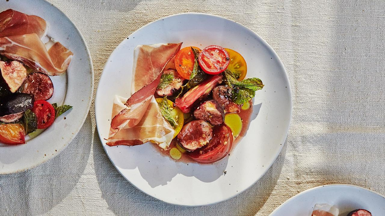 "This salad is a riff on melon and prosciutto. We swapped the melon for jammy figs and sweet tomatoes. <a href=""https://www.bonappetit.com/recipe/tomatoes-with-fig-and-prosciutto?mbid=synd_yahoo_rss"">See recipe.</a>"