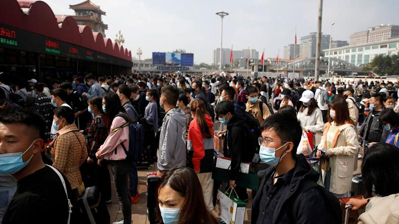 Crowds of people outside Beijing Railway station