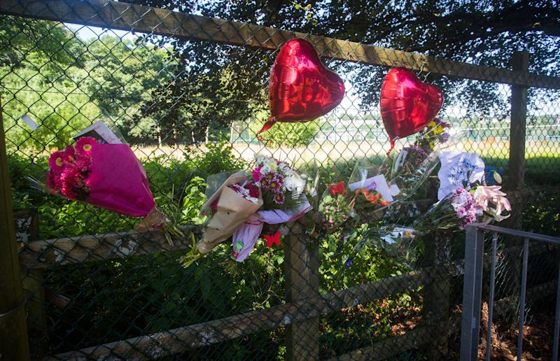 Flowers have outside of the Tavistock College in Devon, in tribute to Hannah Bragg (Picture: SWNS)