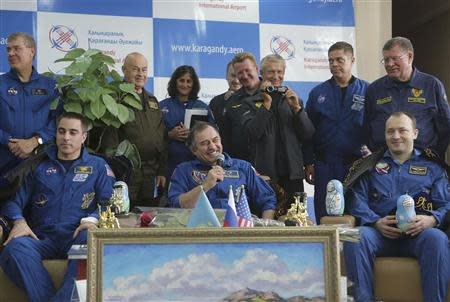Russian cosmonauts Alexander Misurkin (R) and Pavel Vinogradov (C) and US astronaut Chris Cassidy (L) attend a press conference at the airport in Karaganda, Kazakhstan, September 11, 2013. REUTERS/Maxim Shipenkov/Pool