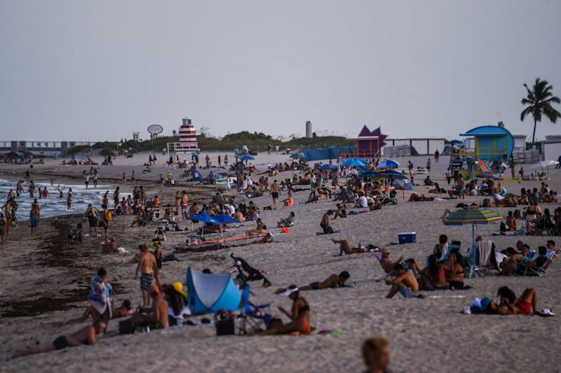 People relax on the beach in Miami Beach in Florida amid the coronavirus pandemic.