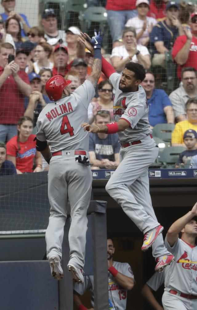 St. Louis Cardinals' Yadier Molina celibates his two-run home run with Jose Martinez during the sixth inning of a baseball game against the Milwaukee Brewers Saturday, June 23, 2018, in Milwaukee. (AP Photo/Morry Gash)