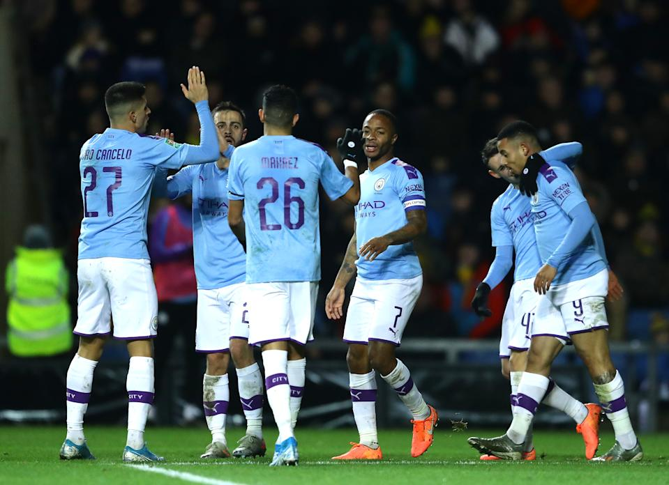OXFORD, ENGLAND - DECEMBER 18: Raheem Sterling of Manchester City celebrates with teammates after scoring his team's third goal  during the Carabao Cup Quarter Final match between Oxford United and Manchester City at Kassam Stadium on December 18, 2019 in Oxford, England. (Photo by Richard Heathcote/Getty Images)