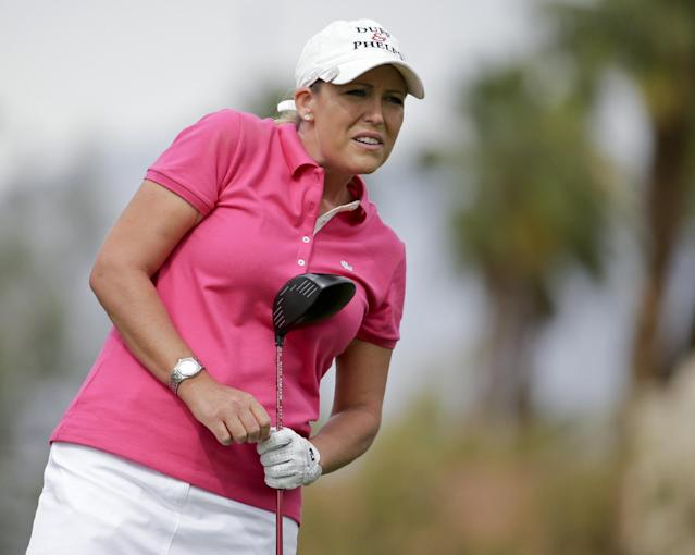 Cristie Kerr watches her tee shot on the 11th hole during the second round of the Kraft Nabisco Championship golf tournament Friday, April 4, 2014, in Rancho Mirage, Calif. (AP Photo/Chris Carlson)