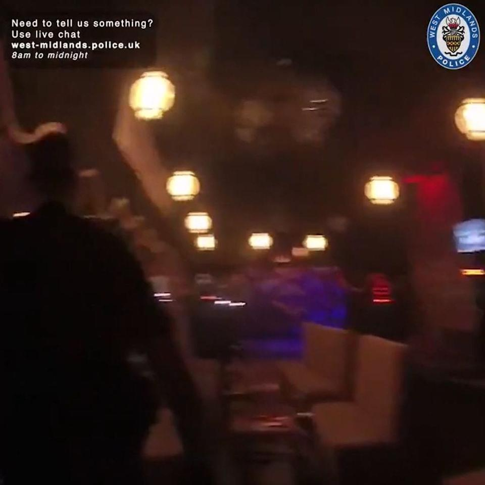 A screen grab of undated bodycam footage issued by West Midlands Police shows officers raiding the Kasablanca shisha lounge in Birmingham -  West Midlands Police / PA