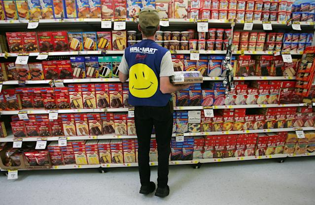 Walmart employee restocks a shelf in the grocery section of a Wal-Mart Supercenter in Troy, Ohio.