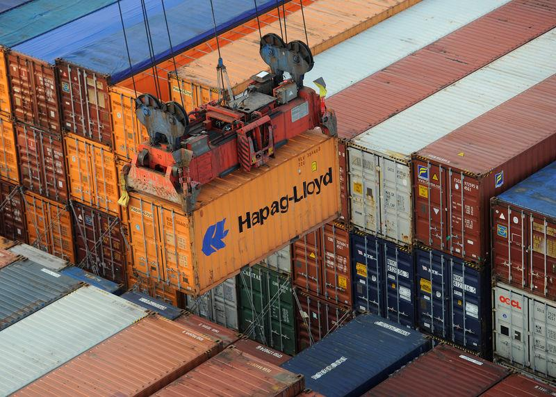 FILE PHOTO: A Hapag-Lloyd container is loaded from a container ship at the terminal Altenwerder in the harbour in Hamburg