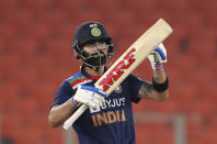India's captain Virat Kohli gestures after scoring fifty runs during the fifth Twenty20 cricket match between India and England at Narendra Modi Stadium in Ahmedabad, India, Saturday, March 20, 2021. (AP Photo/Ajit Solanki)
