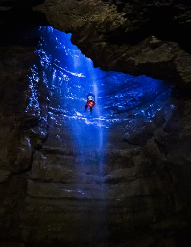 A potholer is winched into Gaping Gill (Danny Lawson/PA)