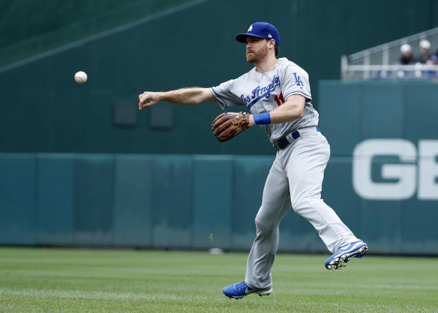 Los Angeles Dodgers second baseman Logan Forsythe throws to first base for the out on Washington Nationals' Howie Kendrick during the fourth inning of the first baseball game of a doubleheader at Nationals Park, Saturday, May 19, 2018, in Washington. (AP Photo/Alex Brandon)