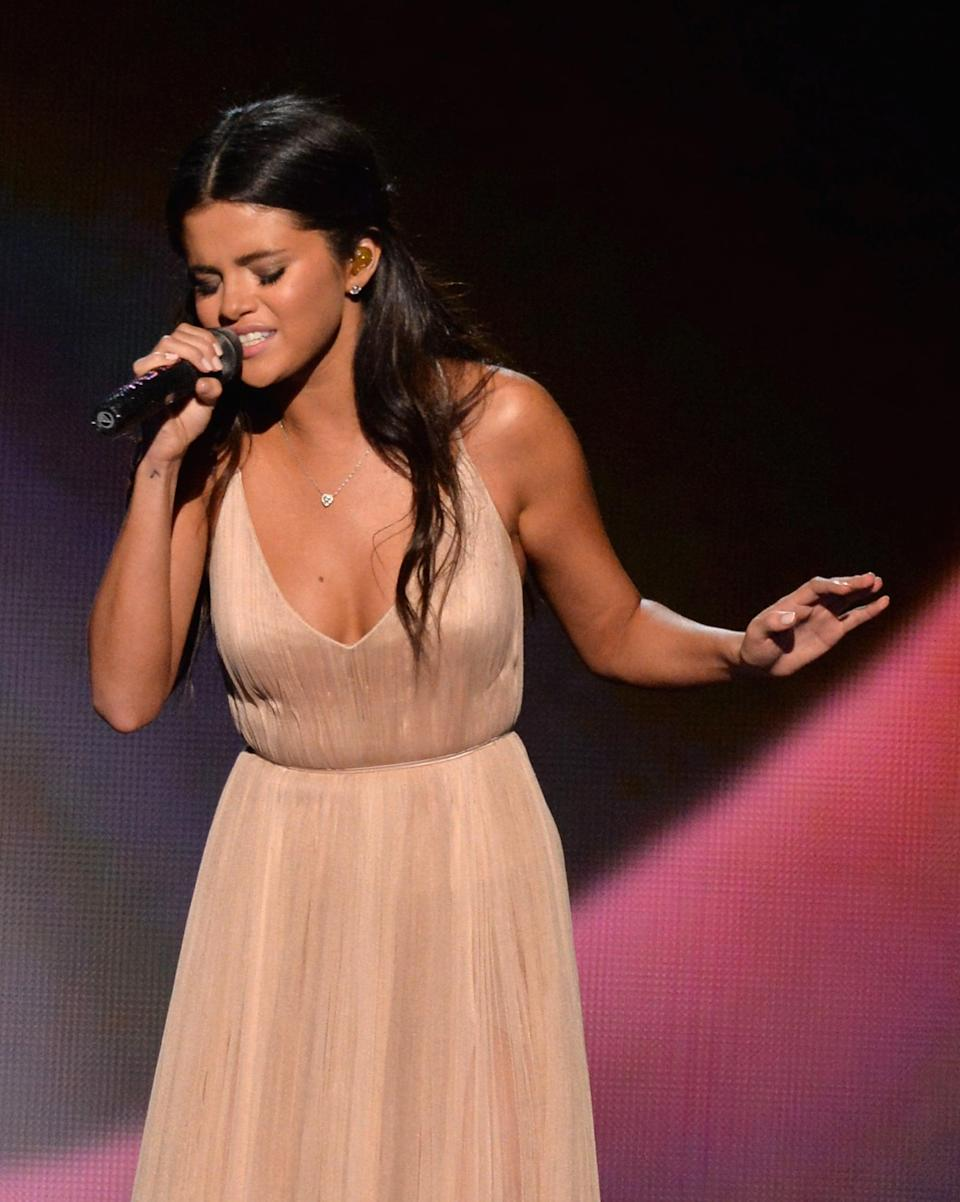 """<p>Selena delivered <a href=""""https://www.popsugar.com/entertainment/Selena-Gomez-Heart-Wants-What-Wants-AMA-Performance-36161806"""" class=""""link rapid-noclick-resp"""" rel=""""nofollow noopener"""" target=""""_blank"""" data-ylk=""""slk:a heart wrenching performance"""">a heart wrenching performance</a> of her single """"The Heart Wants What It Wants"""" at the American Music Awards. </p>"""