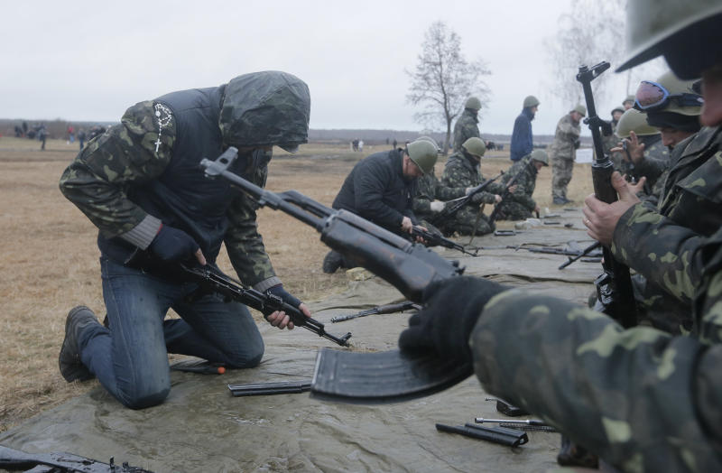 Self-Defense activists perform military exercises at a military training ground outside Kiev, Ukraine, Monday, March 17, 2014. Ukraine's parliament on Monday voted partial mobilization in response to Russia's invasion onto the Ukrainian territory. (AP Photo/Efrem Lukatsky)