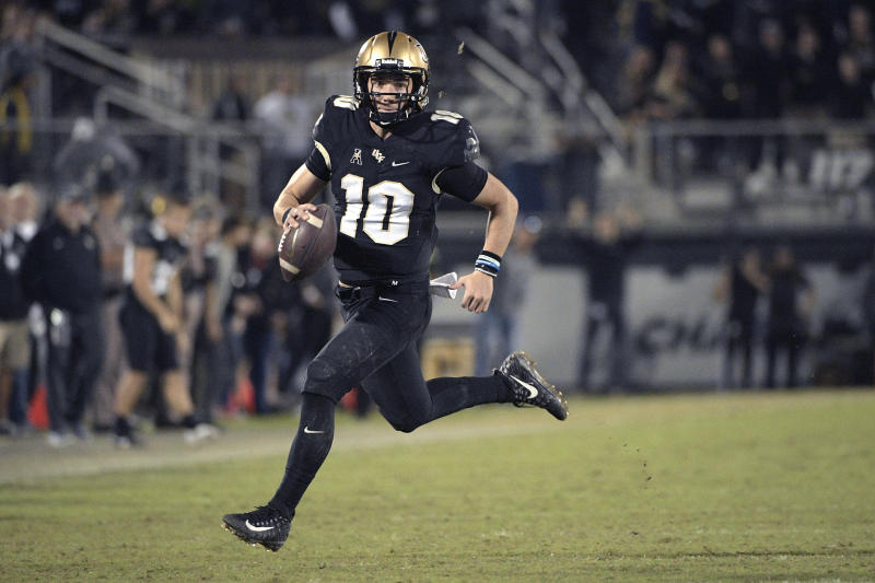 Central Florida quarterback McKenzie Milton (10) rushes for yardage during the second half of an NCAA college football game against Cincinnati Saturday, Nov. 17, 2018, in Orlando, Fla. (AP Photo/Phelan M. Ebenhack)
