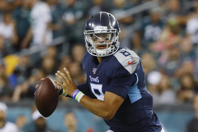 FILE - In this Aug. 8, 2019, file photo, Tennessee Titans quarterback Marcus Mariota (8) looks to pass during a preseason NFL football game against the Philadelphia Eagles in Philadelphia. The Titans are paying Mariota $20.9 million, and the No. 2 draft pick overall in 2015 will have to earn his next contract. He has yet to play a full 16-game season in the NFL and missed three starts last season, including the regular season finale with a playoff berth on the line for the winner. (AP Photo/Matt Rourke, File)