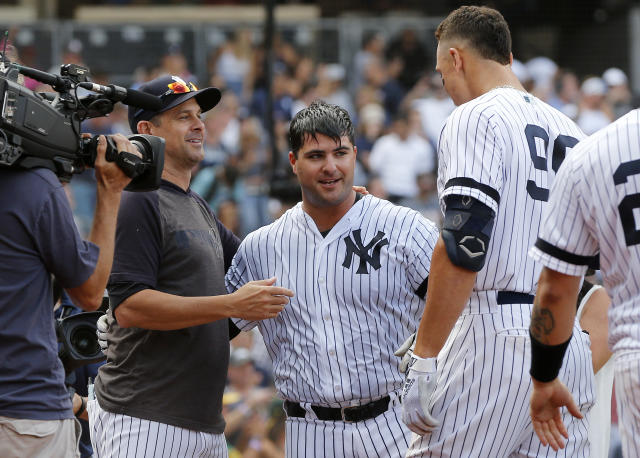 NEW YORK, NEW YORK - SEPTEMBER 01: Mike Ford #36 of the New York Yankees celebrates his ninth inning pinch hit game winning home run against the Oakland Athletics with teammate Aaron Judge #99 and manager Aaron Boone at Yankee Stadium on September 01, 2019 in New York City. (Photo by Jim McIsaac/Getty Images)