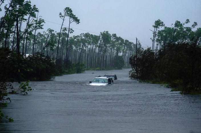 Cars sit submerged in water from Hurricane Dorian in Freeport, Bahamas, Sept. 3, 2019. (Photo: Ramon Espinosa/AP)
