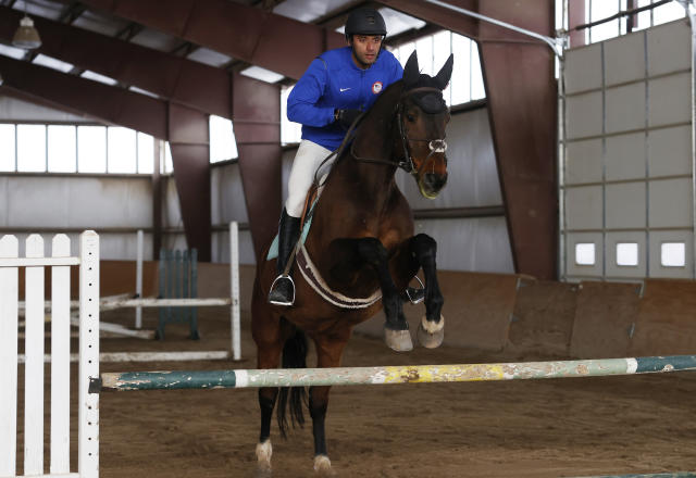 USA Olympic modern pentathlon team member Amro ElGeziry jump his horse, Chino, during practice at a stable in Fountain, Colo., Friday, April 24, 2020. (AP Photo/David Zalubowski)