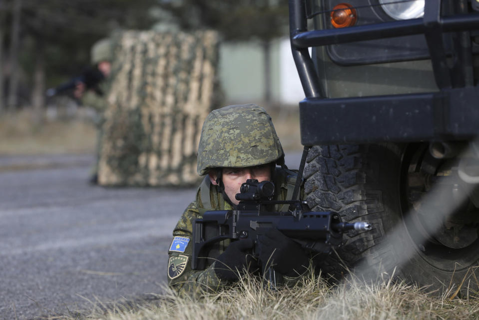 Member of Kosovo's Security Forces takes part in a exercise in southeastern town of Gjilan, Kosovo on Thursday, Dec. 13, 2018, a day before the parliament votes to transform them into a regular army. Kosovo lawmakers are set to transform the Kosovo Security Force into a regular army, a move that significantly heightened tension with neighboring Serbia which even left open a possibility of an armed intervention in its former province. (AP Photo/Visar Kryeziu)