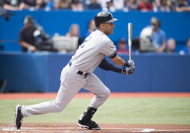 New York Yankees' Derek Jeter hits a single during the first inning of a baseball game against the Toronto Blue Jays in Toronto, Sunday, Aug. 31, 2014. (AP Photo/The Canadian Press, Darren Calabrese)