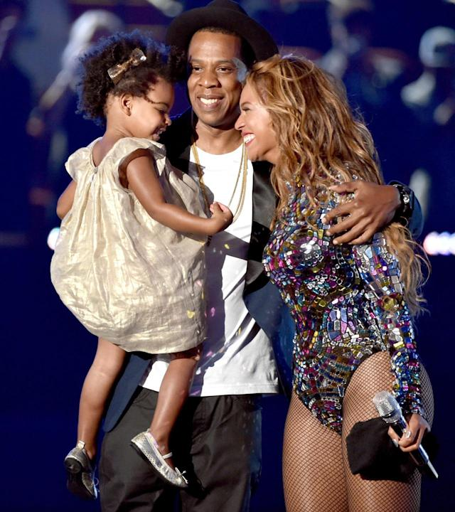 "<p>It's only fitting that Blue made her actual awards show debut at the VMAs — three years after Bey debuted her bump at that show. It was a big year for the ""Drunk in Love"" singer with a bunch of nominations and she was also the Michael Jackson Video Vanguard Award recipient. Jay and Blue joined her onstage and it was certainly an emotional time or the family. She cried and they group hugged and the whole thing pulled on our heartstrings, especially because not long before she opened up about suffering a miscarriage. (Photo: Kevin Winter/MTV1415/Getty Images for MTV) </p>"