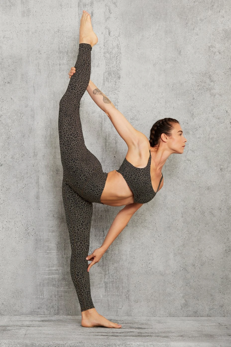 """<h3>Alo Yoga Vapor Leopard Print Legging<br></h3><br>Alo Yoga's """"Vapor"""" fabric is their answer to engineered-to-be-airy materials like Nulu and TechSweat, and it appears to be coming for the activewear throne. The compressive, lifting fit is augmented by an ultralight, second-skin feel that has customers very satisfied. (One glowing review from a personal trainer called Alo's quality """"the best there is."""")<br><br><strong>Alo Yoga</strong> High Waist Vapor Legging, $, available at <a href=""""https://go.skimresources.com/?id=30283X879131&url=https%3A%2F%2Fwww.aloyoga.com%2Fproducts%2Fw5839r-high-waist-vapor-leopard-legging-olive-branch"""" rel=""""nofollow noopener"""" target=""""_blank"""" data-ylk=""""slk:Alo Yoga"""" class=""""link rapid-noclick-resp"""">Alo Yoga</a>"""