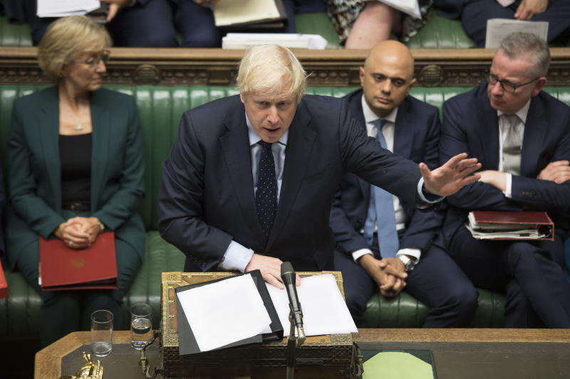 In this image released by the House of Commons, Britain's Prime Minister Boris Johnson speaks in the House of Commons, London, Tuesday Sept. 3, 2019. British Prime Minister Boris Johnson suffered key defections from his party Tuesday, losing a working majority in Parliament and weakening his position as he tried to prevent lawmakers from blocking his Brexit plans. (Jessica Taylor/House of Commons via AP)