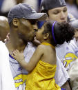 FILE - In this June 14, 2009 file photo Los Angeles Lakers' Kobe Bryant kisses his daughter, Gianna, after defeating the Orlando Magic 99-86 in Game 5 to win the NBA basketball finals in Orlando, Fla. Bryant, the 18-time NBA All-Star who won five championships and became one of the greatest basketball players of his generation during a 20-year career with the Los Angeles Lakers, died in a helicopter crash Sunday, Jan. 26, 2020. Gianna also died in the crash. (AP Photo/David J. Phillip)