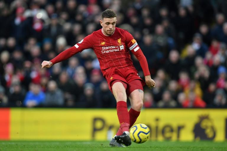 Liverpool captain Jordan Henderson was among the players to post about #PlayersTogether (AFP Photo/Paul ELLIS)